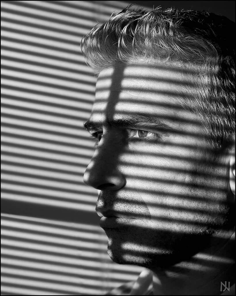 Jack Nobre - window blind shadows portrait