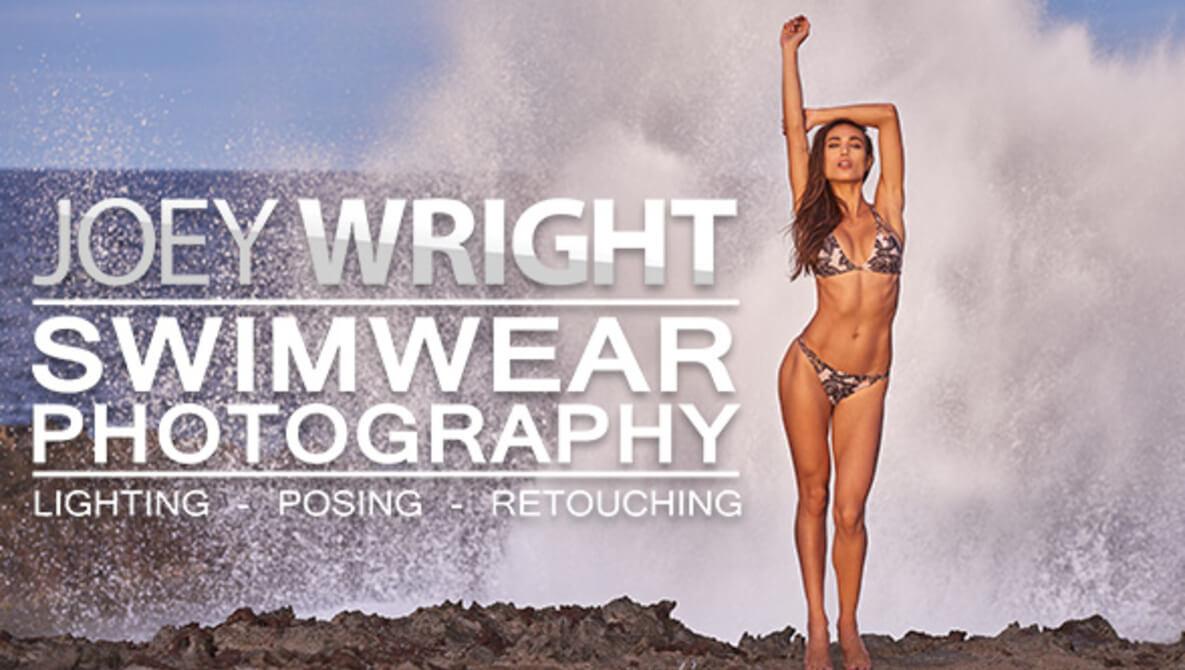 Swimwear model poses in front of crashing waves