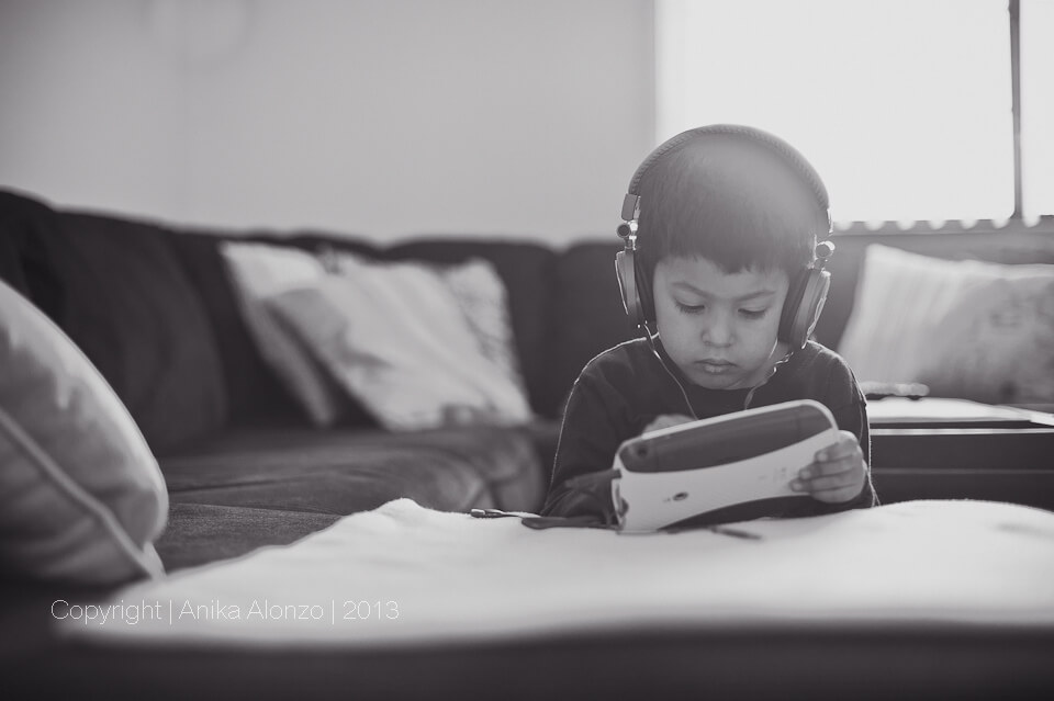 photography by anika alonzo - kid wearing headphones
