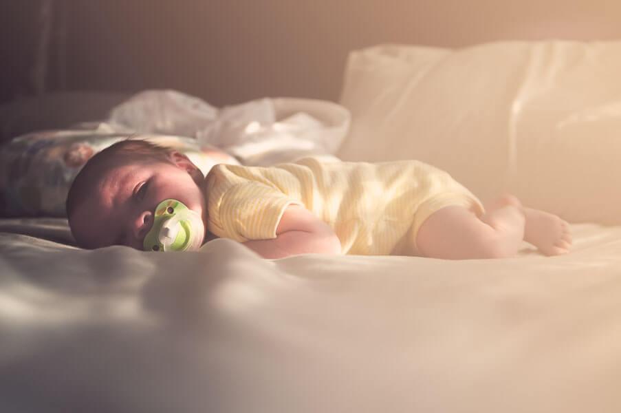 jordan parks - baby on bed