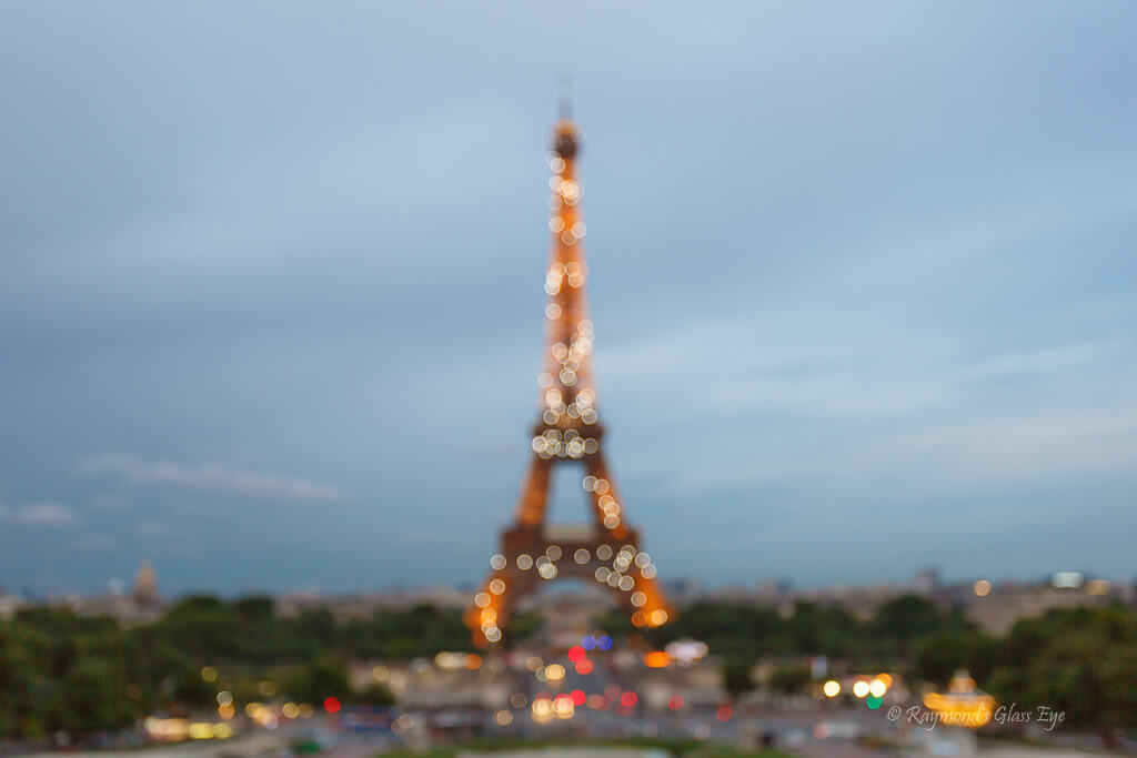 Raymonds Glass Eye - Eiffel Tower Bokeh