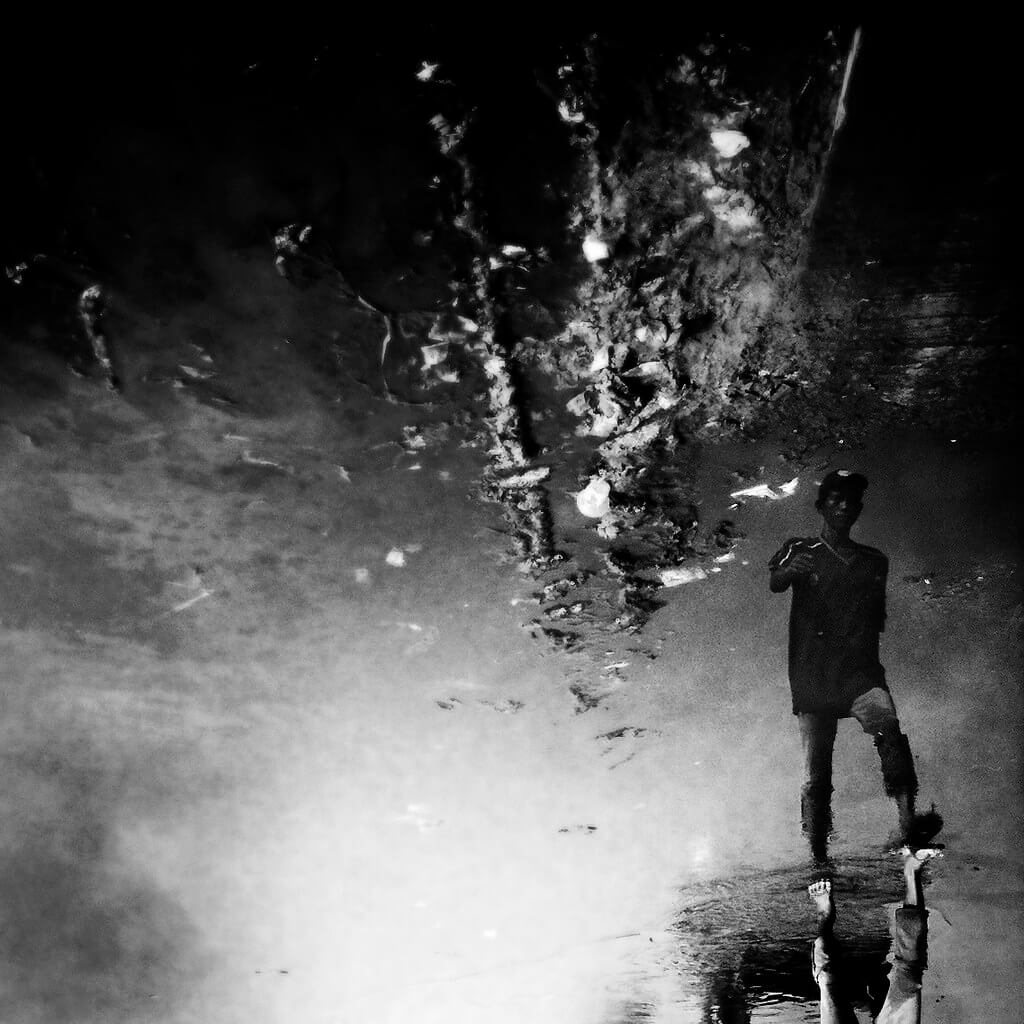Shirren Lim - puddle reflection black and white