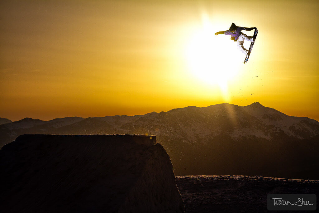 Tristan 'Shu' Lebeschu - Tail Grab Snowboarder at Sunset
