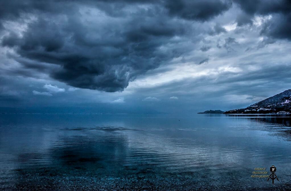 Theseus Troizinian - storm cloud over water