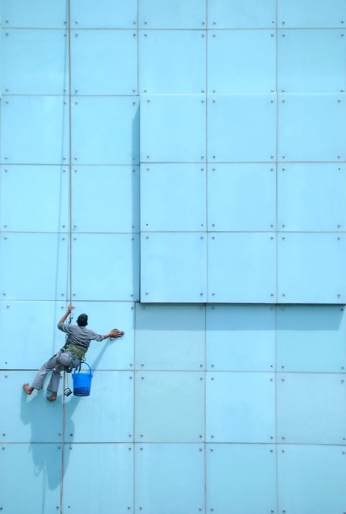 Nimit Nigam - Guy Cleaning Windows of Hotel New Delhi