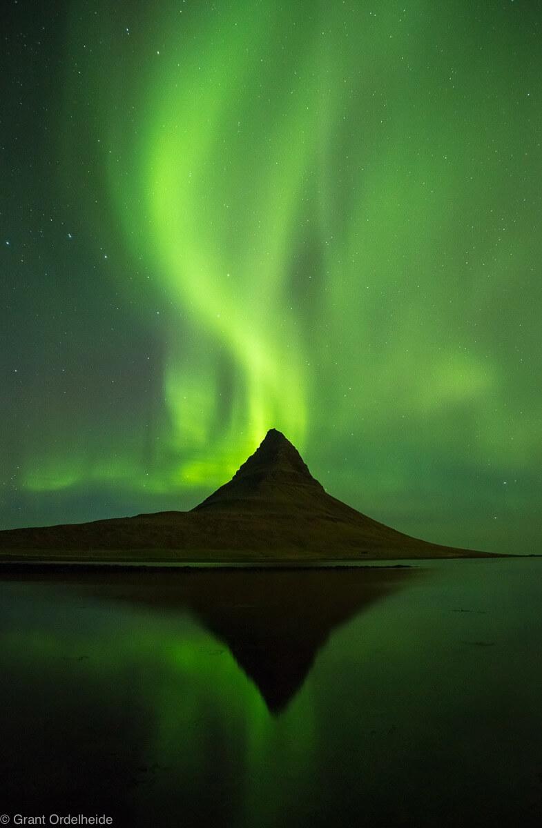 Grant Ordelheide - Auora borealis over Kirkjufell mountain in western Iceland