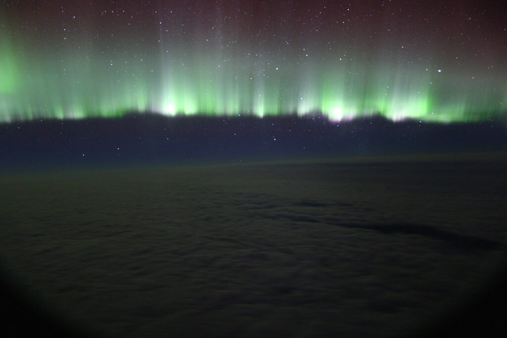 Paul Williams - northern lights through plane window