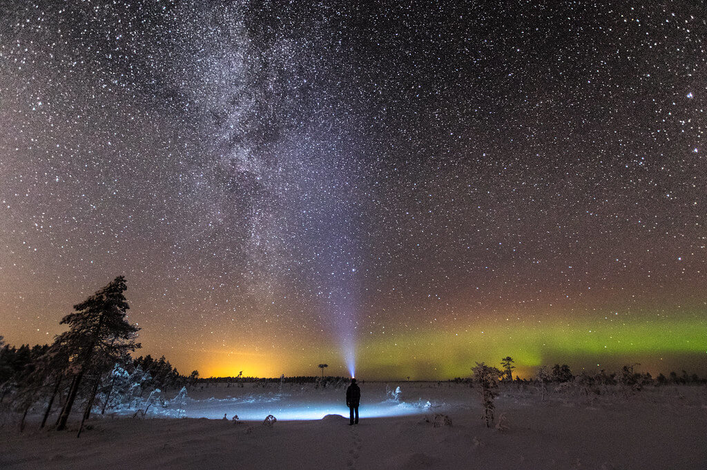 Juho Holmi - northern lights with flashlight