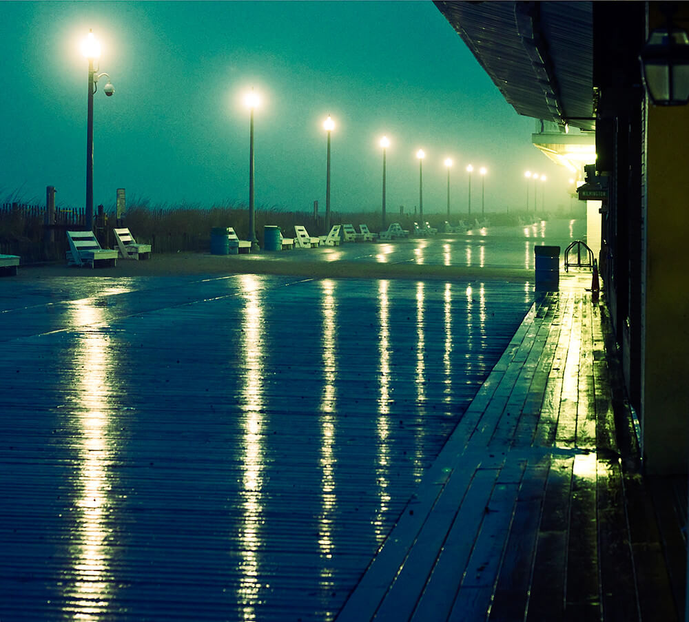 Victoria Pickering - Rehoboth Beach boardwalk in the rain at sunset