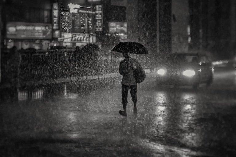 Mohammad Rokonuzzaman khan - walk in rain