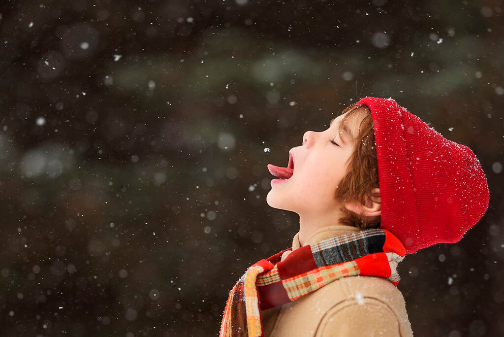 Elizabeth Sallee Bauer - Boy catching snowflake on tongue