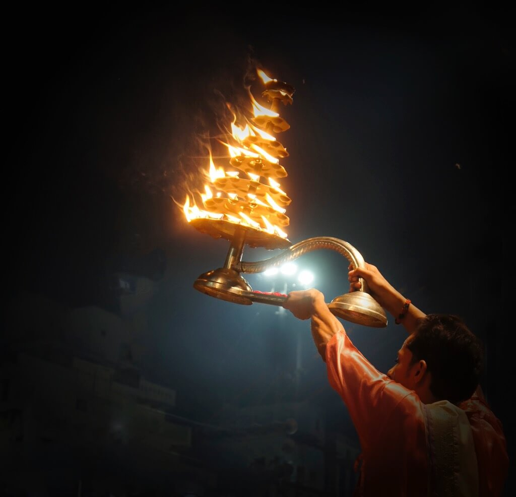 Manish (Valmie) Joshi - Priest performs Aarti ritual at the River Ganga