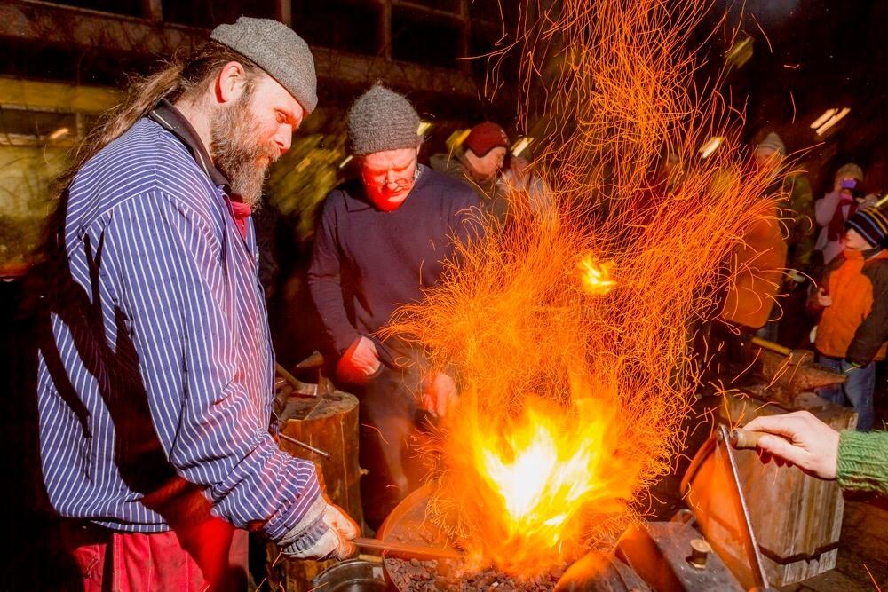Ragnar Th. Sigurdsson - Blacksmith artist creating ironworks during the annual Winter Festival, Reykjavik, Iceland