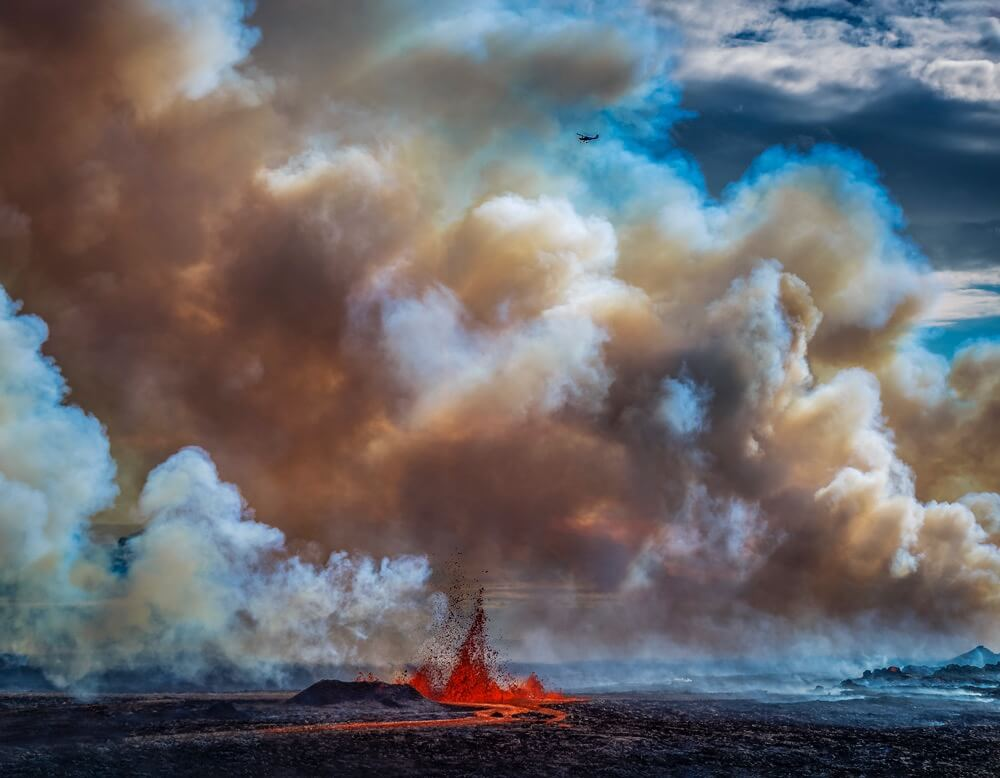Ragnar Sigurdsson - Small plane flying over the volcano eruption at the Holuhruan Fissure, Bardarbunga Volcano, Iceland.