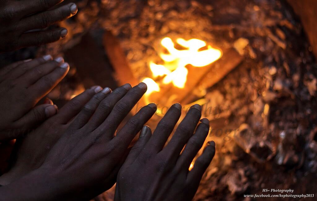 Harjeet Singh Narang - hands warming by the fire