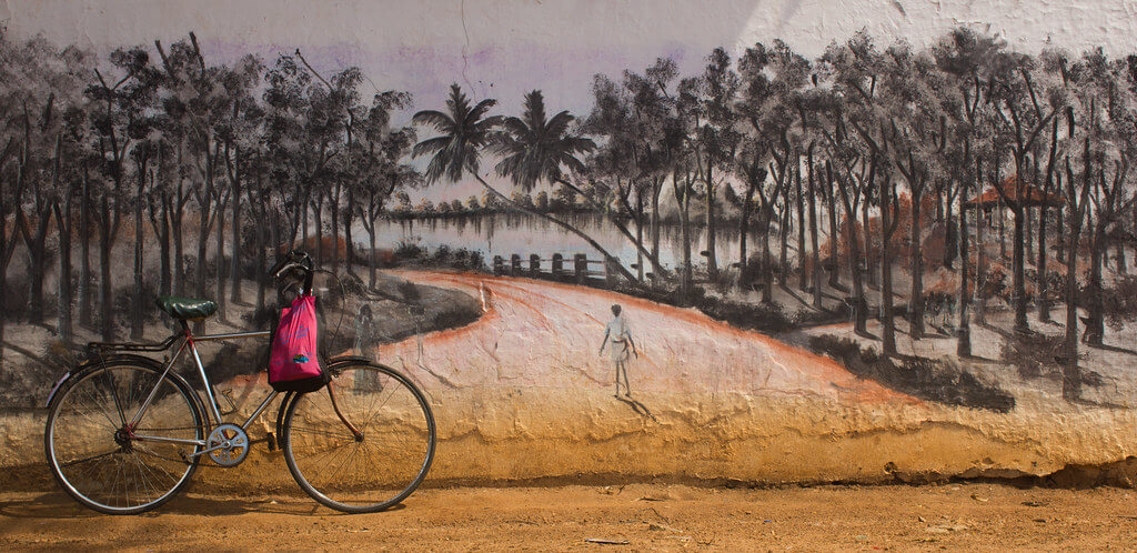 Praphul T - Bicycle against wall mural