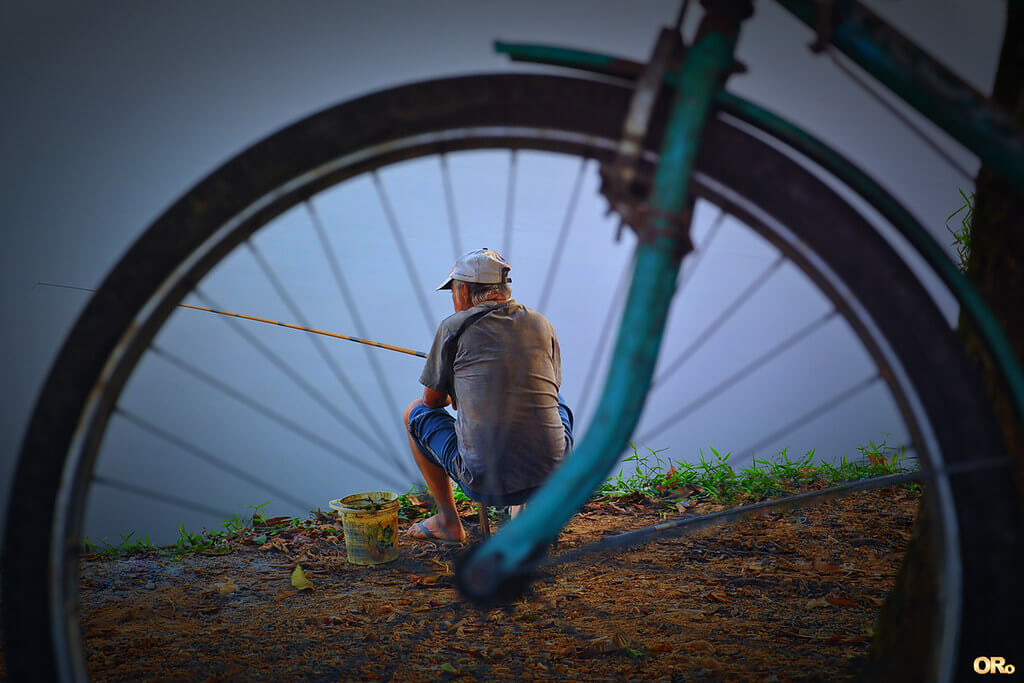 Otacílio Rodrigues - A fisherman and his bike