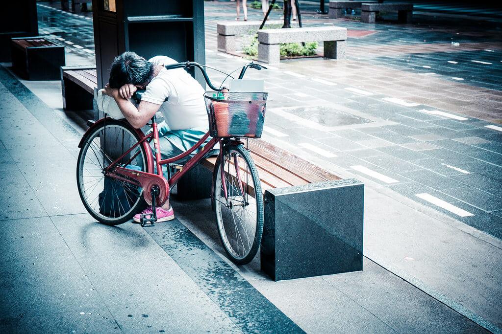 Bryon Lippincott - sleeping on bicycle