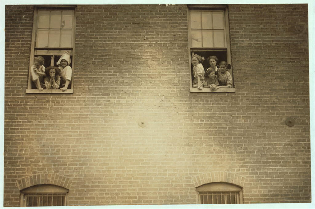 Lewis Wickes Hine - girls looking out window at cigarette factory