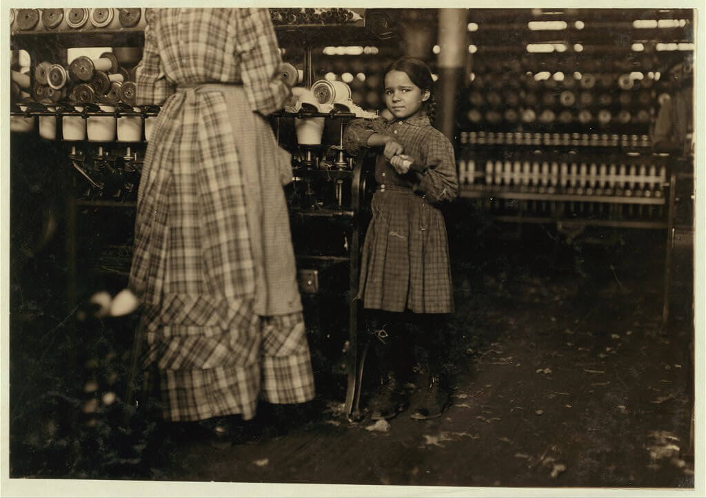 Lewis Wickes Hine - girl helping sister at mill