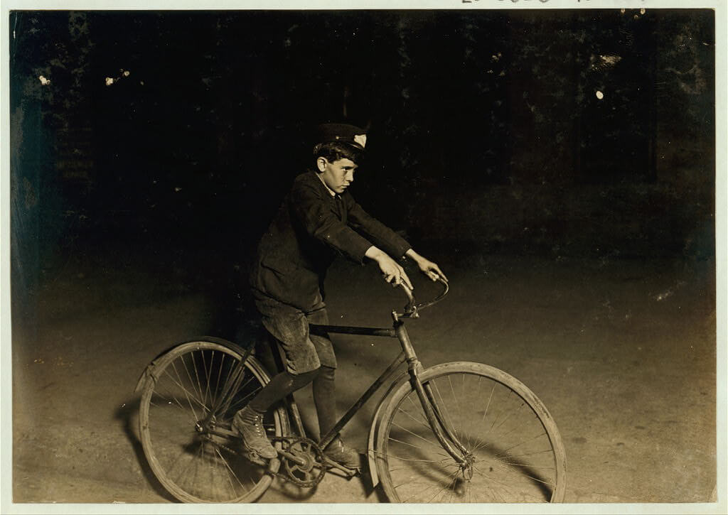 Lewis Wickes Hine - messenger boy on bike at night