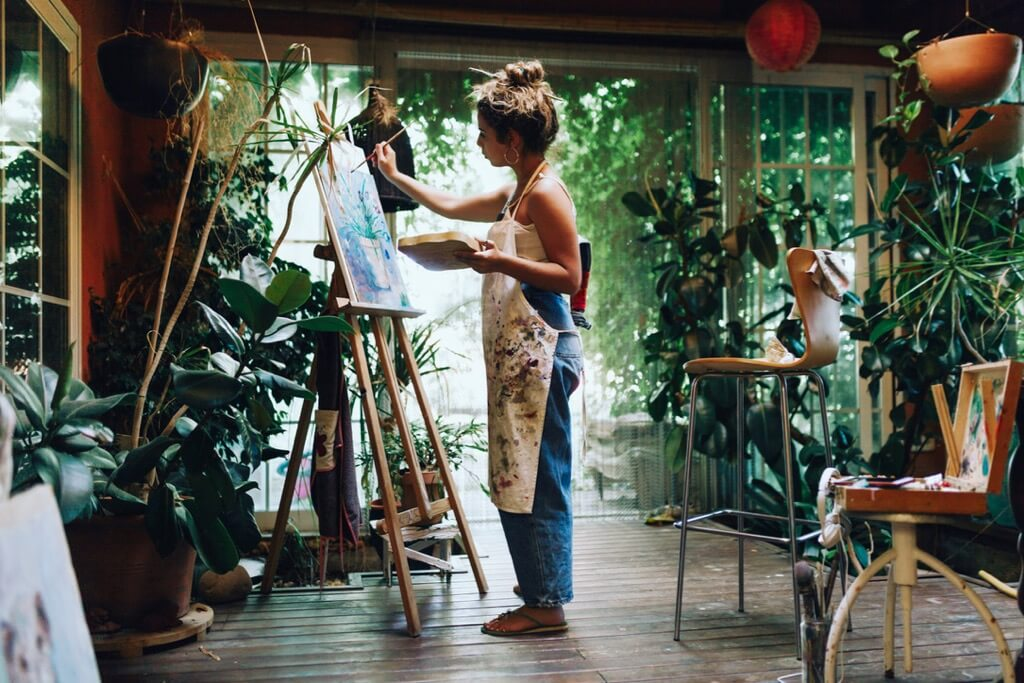Woman painter in her painting studio.