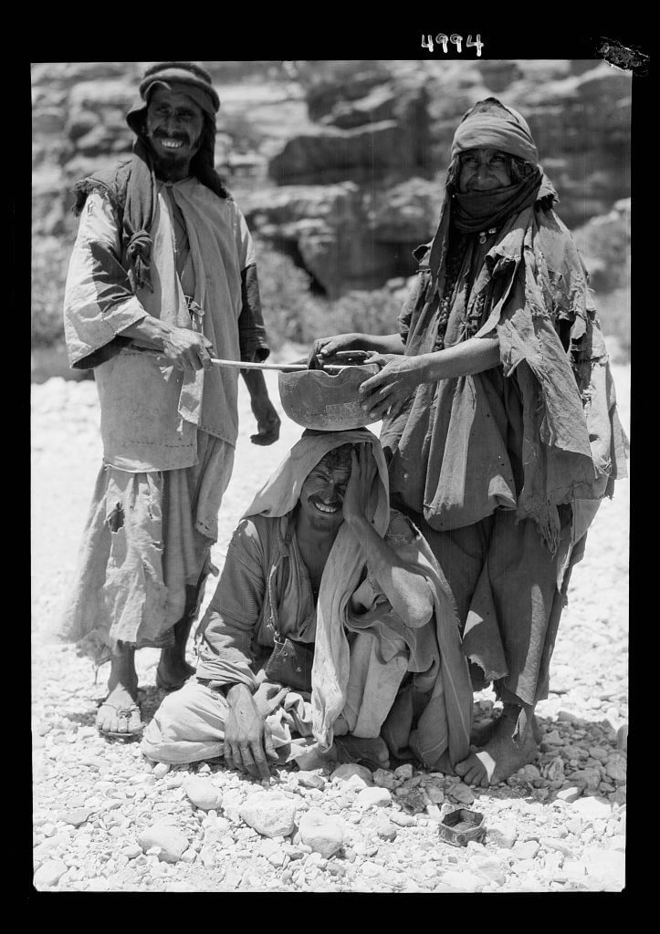 Bedouins performing an incantation over a sick man