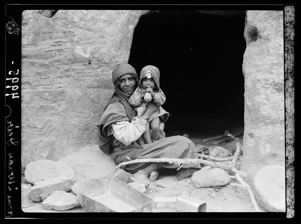 Bedouins Mother and baby before their cave home