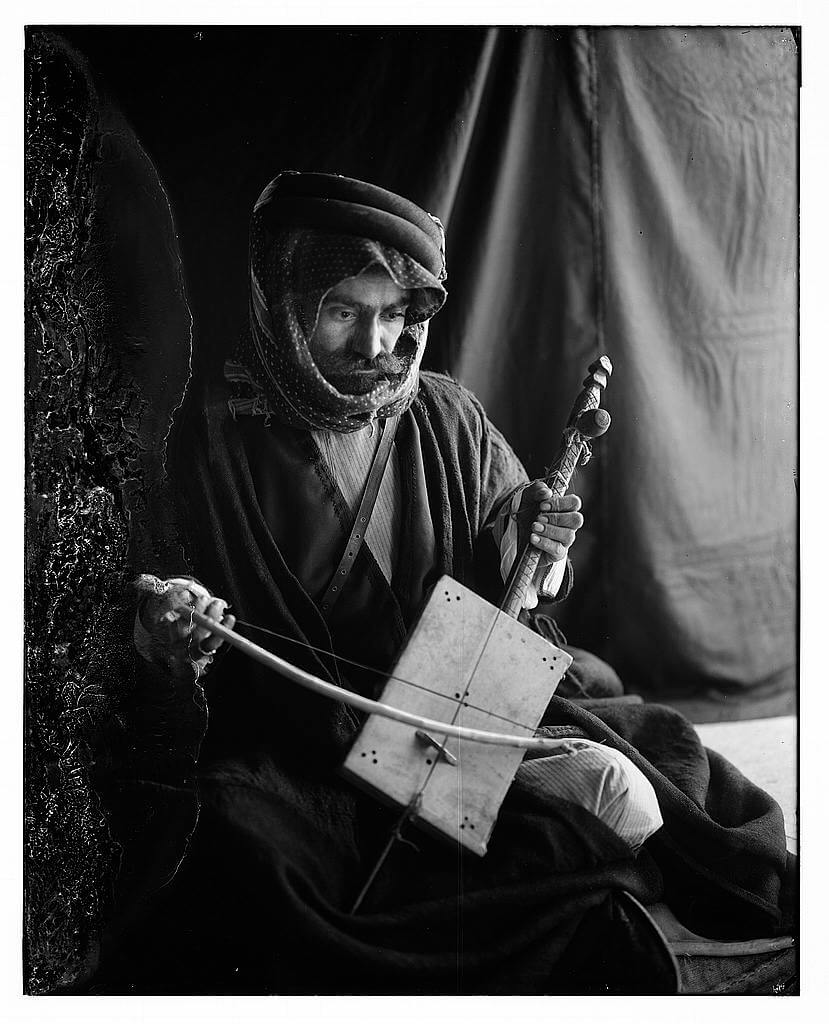 Bedouin man playing the rababeh with a bow