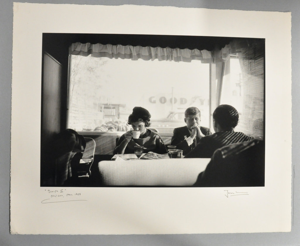 Sen. John F. Kennedy, Jacqueline Kennedy, and Stephen Smith (back facing camera) have a quiet Sunday morning breakfast after Mass while on the campaign trail in Oregon, 1959. This photo became one of Jacques Lowe's most requested images. © The Estate of Jacques Lowe.