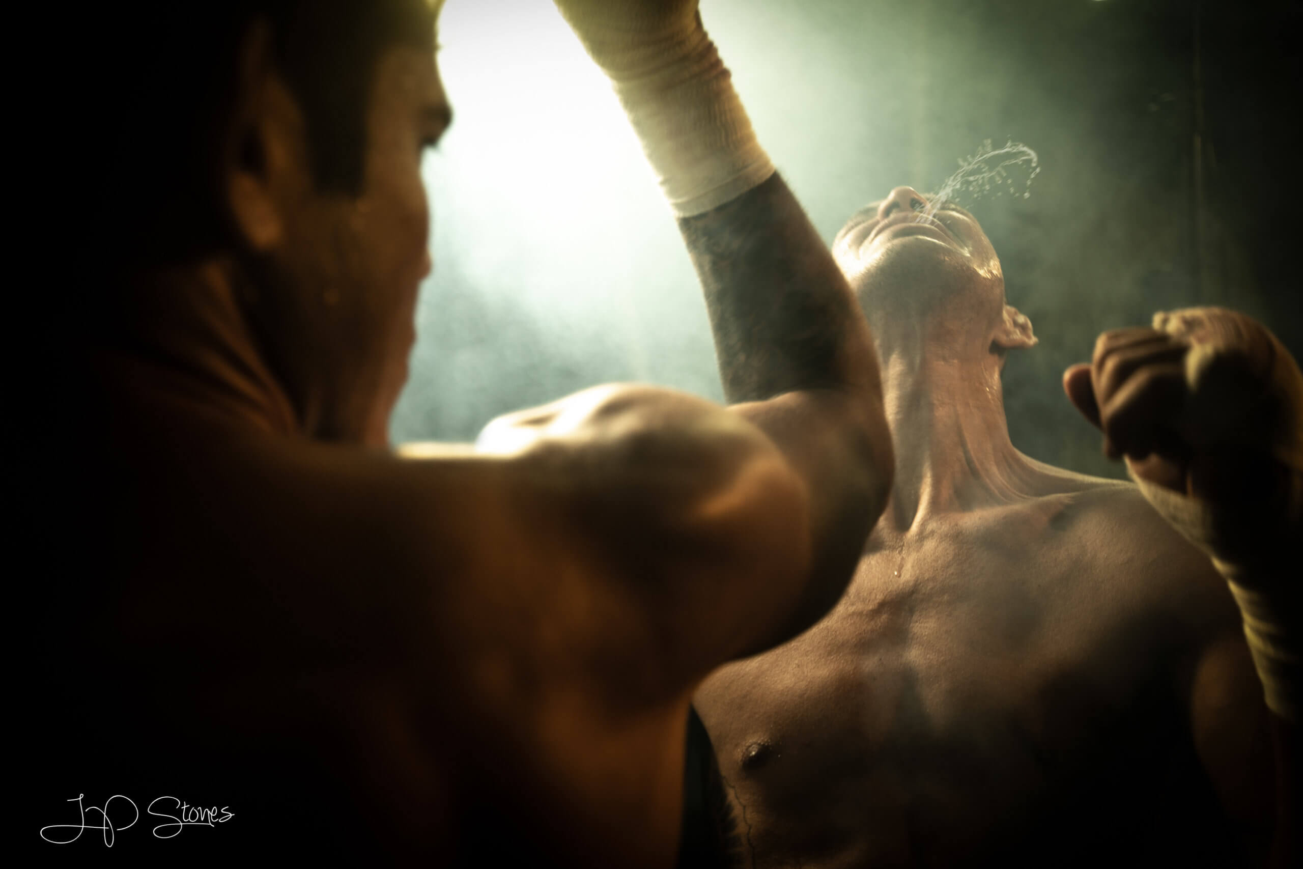 cinematic photography of boxer getting hit