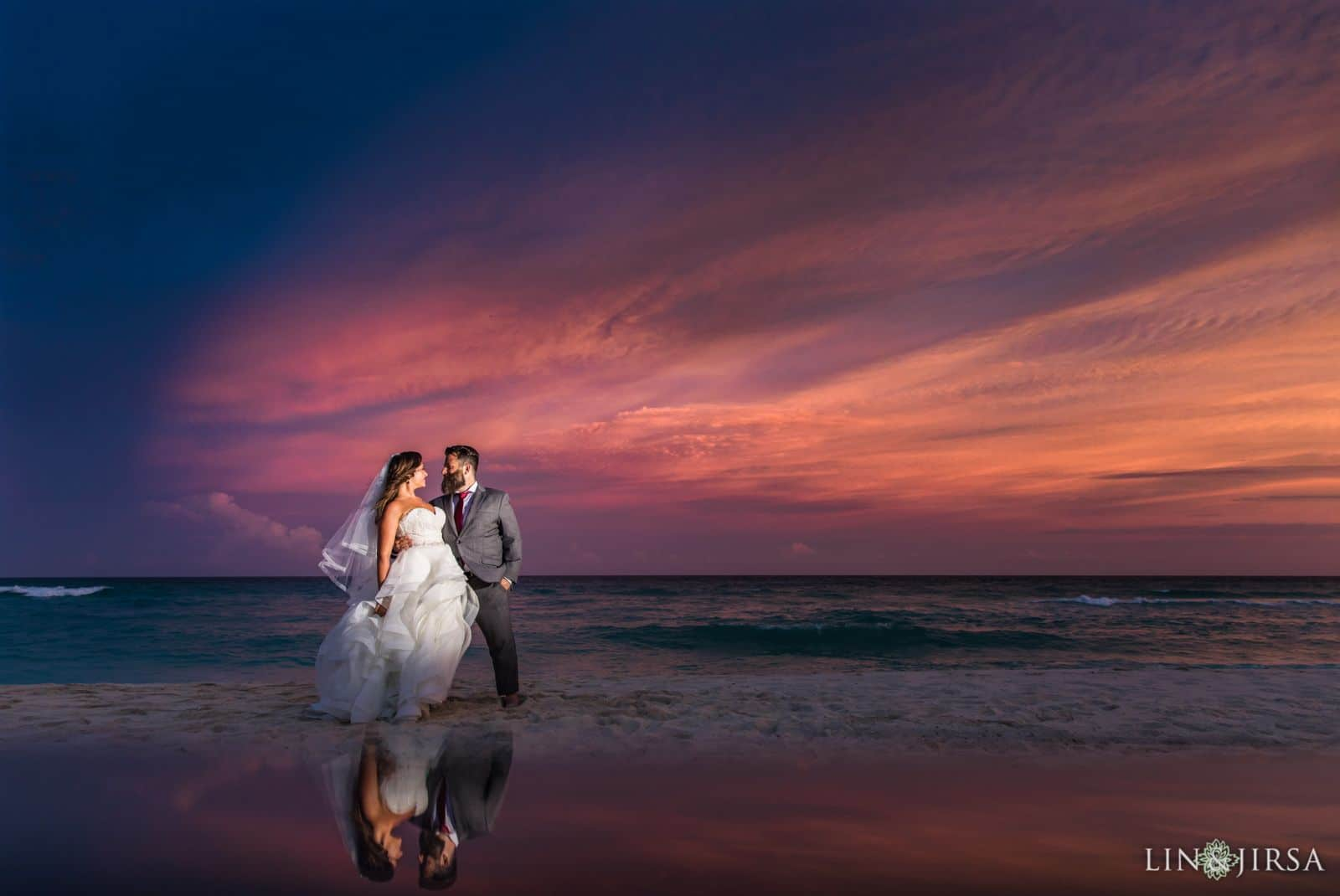 negative space photography couple reflected on beach at sunset