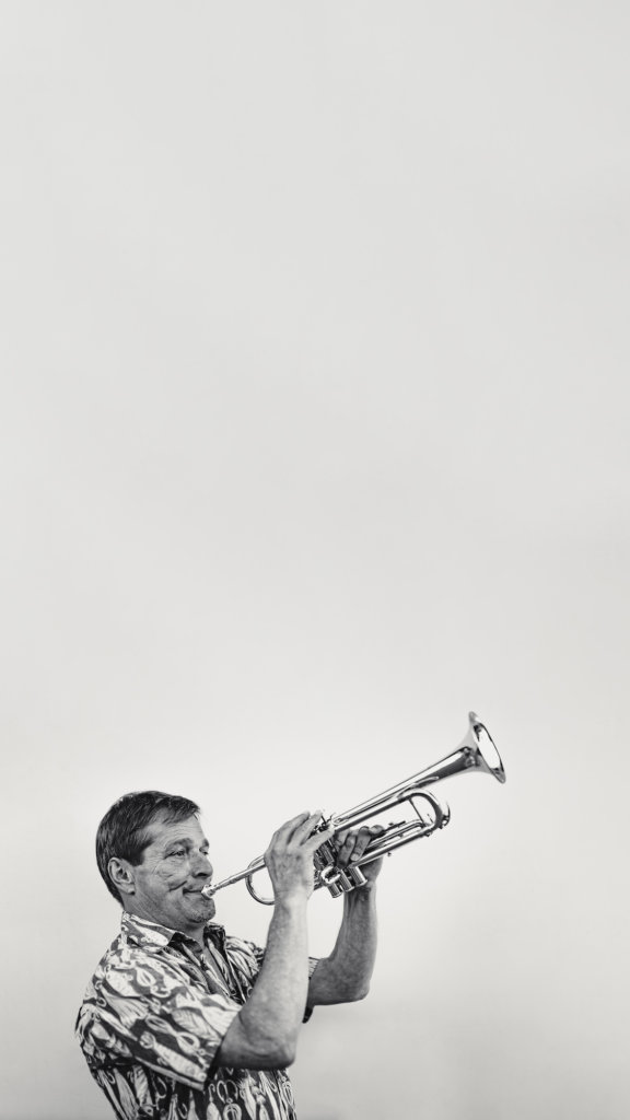 negative space photography with trumpeter in black and white