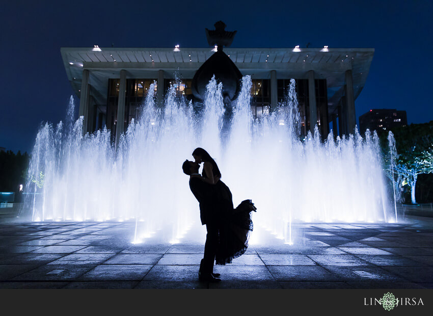 negative space photography couple in front of fountain