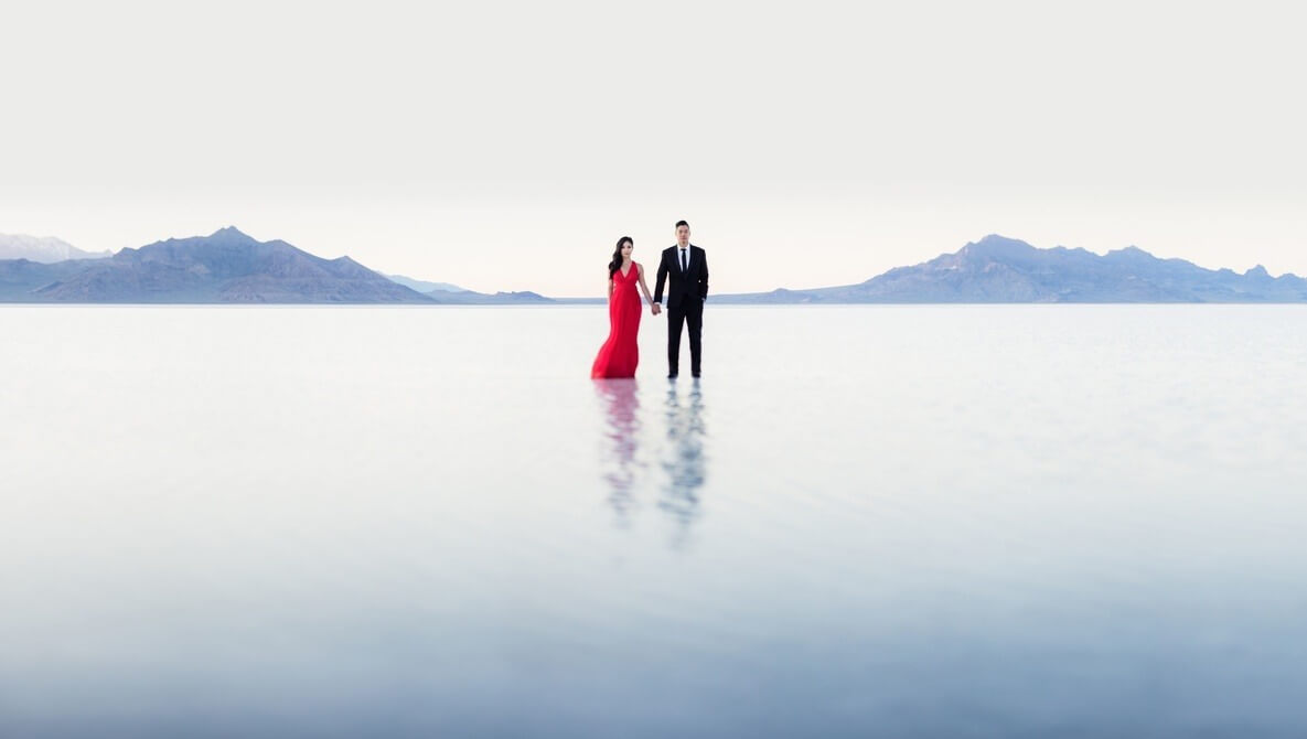 negative space photography couple in salt flats